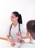 Doctor refusing bribing. Young female doctor is insulted by patient's bribing and she refusing money Stock Photo