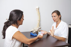 Doctor refusing cash payment. Patient paying for medical treatment with cash Royalty Free Stock Photography