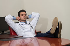 Doctor Relaxing On Office Chair Royalty Free Stock Photo