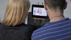 Doctor reports the results of the medical examination by video chat with a married couple. on-line medicine