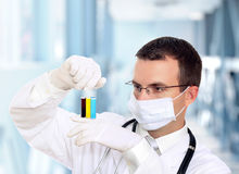 Doctor  resarch a medical test glass with urine. Royalty Free Stock Image