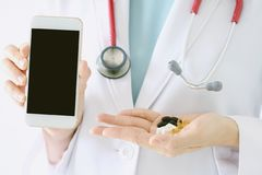 Doctor research medicine on mobile, Doctor hand holding smartphone. Doctor research medicine on mobile, Doctor hand holding smartphone and pills, Electronic royalty free stock photos