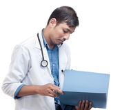 Doctor Reviewing Medical Record Stock Photo