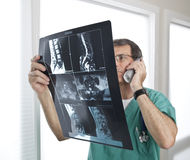 Doctor Reviewing Patient Radiology Scans and Discu Royalty Free Stock Photography