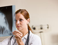 Doctor reviewing x-rays in doctor office Royalty Free Stock Photography
