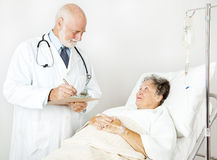 Doctor Reviews Medical History Stock Photography