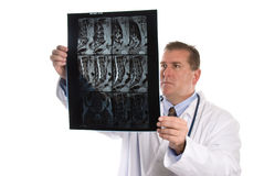 Doctor reviews X-rays Royalty Free Stock Images