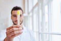Doctor rungs urine sample analysis Royalty Free Stock Photos