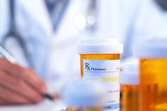 Doctor with RX prescription. Drug bottle selective focus royalty free stock photography