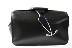 Doctor's bag. Black leather doctor's bag with stethoscope hanging out Royalty Free Stock Photos