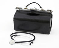 Doctor's bag with stethoscope lying near Royalty Free Stock Photo
