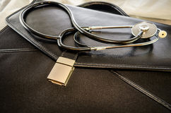 Doctor's briefcase and stethoscope Stock Images