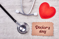 Doctor`s Day card and stethoscope. Royalty Free Stock Images