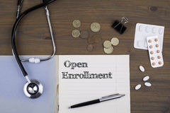 Doctor's desk with notebook and text - Open Enrollment Royalty Free Stock Photos