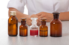 Doctor's hand with bottles of medicine Stock Photos