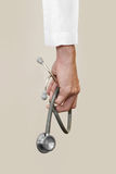 Doctor's hand holding stethoscope Stock Photography