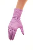 Doctor's hand in purple sterilized surgical glove giving for handshake. Close up of female doctor's hand in purple sterilized surgical glove giving for handshake Stock Photography