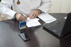 Free Doctor`s Hand Stamped On The Prescription. The Doctor Writes A Prescription At His Desk. Stock Images - 89024324