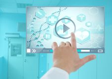 Doctor's Hand touching Medical Video Player App Interface Stock Photo