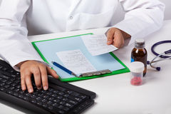Doctor's hand typing on keyboard Stock Photo