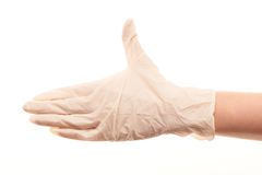 Doctor's hand in white sterilized surgical glove giving for handshake. Close up of female doctor's hand in white sterilized surgical glove giving for handshake Royalty Free Stock Image
