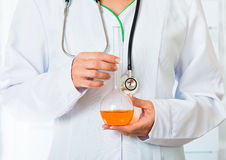 Doctor's hands with flask Royalty Free Stock Photography