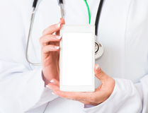 Doctor's hands with mobile phone Royalty Free Stock Image