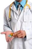 Doctor's Hands With Prescription Pills Stock Photos