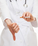 Doctor's hands showing disabling gesture and holding a cigarette royalty free stock photo