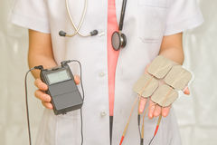 Doctor's hold Medical Tens Unit Royalty Free Stock Image