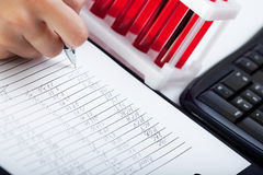 Doctor's medical notes and blood samples. Doctor's medical notes with background of blood samples Royalty Free Stock Photo