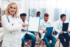 Women Doctor With Paper Notes. Diagnostic Meeting stock image