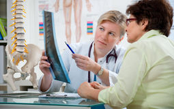 At the doctor's office. Doctor explaining x-ray results to patient Royalty Free Stock Image