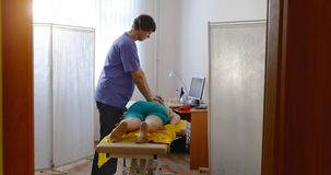 In the doctor`s office osteopath royalty free stock images