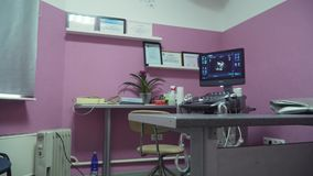Medical equipment, ultrasound machine. Doctor`s office with ultrasound equipment. Interior of examination room with ultrasonography machine in hospital stock footage
