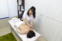 Massage women`s shoulders and waist royalty free stock photography