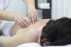 Massage women`s shoulders and waist. royalty free stock image