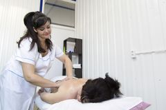 Massage women`s shoulders and waist. stock photography