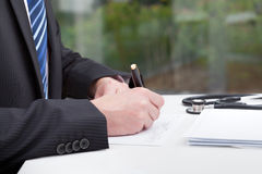 Doctor's paperwork Royalty Free Stock Photo