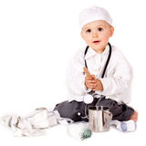 Doctor's play. Young boy wearing as doctor Stock Photography