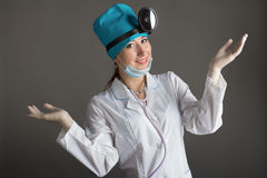 Doctor`s portrait. The woman the doctor in good mood. We wish a good health Royalty Free Stock Photos