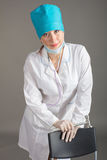 Doctor`s portrait. The woman the doctor in good mood. We wish a good health Royalty Free Stock Photography