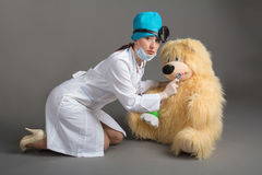 Doctor`s portrait. The woman the doctor in good mood. We wish a good health Royalty Free Stock Image
