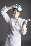 Doctor`s portrait. The woman the doctor in good mood. We wish a good health Stock Images