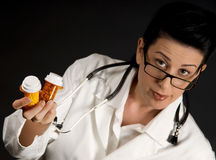 Doctor's Prescription. Medical professional in white coat showing pill bottles Stock Photos