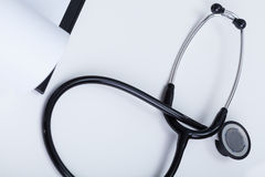 Doctor's stethoscope lies on desk Royalty Free Stock Images