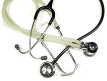 Doctor's Stethoscopes. A black medical stethoscope from a hospital coiled with another stethoscope Stock Photography