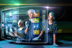 Doctor's team with screens Stock Photos