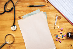 Doctor's work desk, General medical practitioner workspace, top Royalty Free Stock Photo