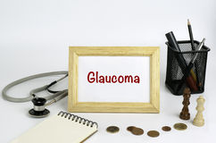 Doctor's working table with the frame and the text - Glaucoma Stock Images